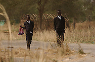 Young boys walk to church for Sunday mass as part of the celebrations in the town of Ayod,  after the referendum for Independence in South Sudan.    (PHOTO: MIGUEL JUAREZ LUGO)