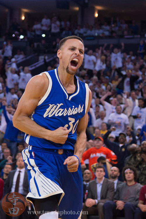 December 25, 2015; Oakland, CA, USA; Golden State Warriors guard Stephen Curry (30) celebrates during the third quarter in a NBA basketball game on Christmas against the Cleveland Cavaliers at Oracle Arena. The Warriors defeated the Cavaliers 89-83.