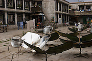Solar water heaters in an apartment courtyard near the Jokhang Monastery, Lhasa, Tibet.