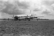29/03/1963<br /> 03/29/1963<br /> 29 March 1963<br /> B.E.A. Aircrash at Dublin Airport. The crashed BEA Vanguard G-APEJ that carried 43 passengers and seven crew from London to Dublin. The Airport Terminal can be seen 1/2 mile in background. Note the Fireman with hose as photographers and gawkers take a look at the accident scene. Photos, Photo, Snap, Streets, Street,