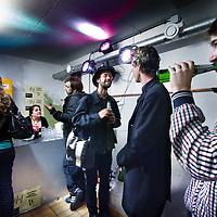 """Nederland, Amsterdam , 13 oktober 2011..Sfeerimpressie van deelnemers van Occupy Amsterdam in het geimproviseerde café van de Vondelbunker onder de brug over het Vondelpark..In het midden (met bril) Samuel 1 van de bedenkers van Occupy Amsterdam..Zaterdag zal het Beursplein in Amsterdam worden bezet door betogers van de inmiddels internationale Occupy-beweging..Wat wel centraal staat in de Occupy-beweging, zoals die ook is ontstaan in New York, is de aversie tegen het monetaire systeem en de daarbij horende hebzucht, zeggen Klifman en Lievense. """"Het is crisis na crisis, maar er is na 2,5 jaar niets veranderd"""", zegt Klifman. """"De beurskredieten, de bonussen, de hebzucht. Het gaat gewoon door."""".Preparing for the global protest Occupy in Amsterdam."""