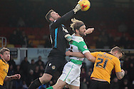 Newport's Goalkeeper Joe Day punches the ball away from Yeovil's Darren Ward. Skybet football league two match, Newport county v Yeovil Town at Rodney Parade in Newport, South Wales on Saturday 21st November 2015.<br /> pic by David Richards, Andrew Orchard sports photography.