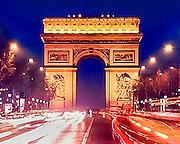 Lights of evening traffic on the Champs-Élysées stream toward the famous monument, the  Arc de Triomphe in Paris, France