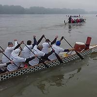 Participants paddle at the 66,6km Diabolic Circle dragon boat race around Szentendre Island on river Danube near Vac, Hungary on Oct. 23, 2020. ATTILA VOLGYI