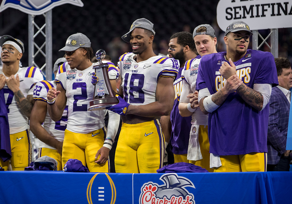 December 28, 2019:  LSU linebacker K'Lavon Chaisson (18) receives defensive player of the game award after NCAA Football game action between the Oklahoma Sooners and the LSU Tigers at Mercedes-Benz Stadium in Atlanta, Georgia.  LSU defeated Oklahoma 63-28.  John Mersits/CSM