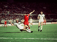 Kevin Keegan (Liverpool) is fouled by Berti Vogts (BMG) for a penalty. Liverpool v Borussia Monchengladbach. The European Cup Final, 1977. Credit: Colorsport.