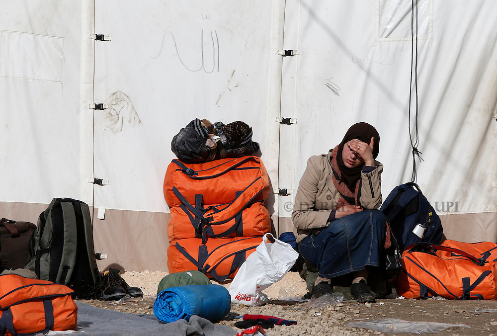 A migrant sits outside a tent as refugees and migrants wait to continue their journey towards western Europe from the Macedonia-Serbia border at a transit camp in the village of Presevo, Serbia, February 2, 2016.<br /> Photo: Darrin Zammit Lupi