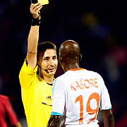 Referee's Pawel Gil with Olympique Marseille's Charles Kabore during their UEFA Europa League third Qualifying round first leg soccer match Eskisehirspor between Olympique Marseille at Ataturk stadium in Istanbul Turkey on Thursday 02 August 2012. Photo by TURKPIX