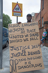 © Licensed to London News Pictures. 08/08/2020. London, UK. Black Lives Matter protestor outside Tottenham Police Station in north London. Photo credit: Marcin Nowak/LNP