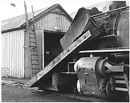 """North end of D&RGW Durango car shop and a partial view of #463 with its large wedge pilot plow.<br /> D&RGW  Durango, CO  <br /> In book """"Durango: Always a Railroad Town (1st ed.)"""" page 50"""