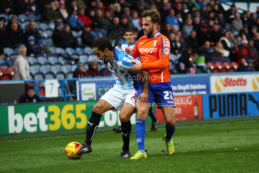 Sean Scannell of Huddersfield Town shields the ball from Andrew Shinnie of Birmingham City. Skybet football league championship match, Huddersfield Town v Birmingham city at the John Smith's stadium in Huddersfield, Yorkshire on Saturday 20th December 2014.<br /> pic by Chris Stading, Andrew Orchard sports photography.