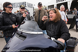 Ann Johnston of Hartford, WI checking out the 2015 Harley-Davidson Street Glide at the Harley-Davidson display at Daytona International Speedway on the first day of Daytona Beach Bike Week 2015. FL, USA. Saturday, March 7, 2015.  Photography ©2015 Michael Lichter.