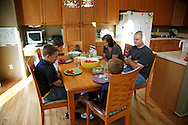 Zachary Frantzen (L) prays with his family before dinner in Longmont, Colorado July 19, 2010.  Zachary, 10, is in the Shapedown Program which is part of the child and teen weight management program at The Children's Hospital in Aurora. L-R are Zachary, brothers Spencer and Trent, mother Leslie, father Mark and brother Joshua.  REUTERS/Rick Wilking (UNITED STATES)