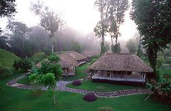 Cabanas in the jungle at a Gallon Jug resort in Belize at Mayan ruins.