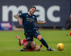 Ayr United's Andy Geggan and Dundee's Declan McDaid. Dundee 1 v 0 Ayr United, Scottish Championship game played 10/8/2019.
