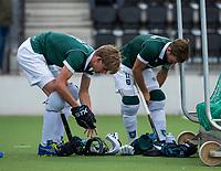 AMSTELVEEN -   Justen Blok (Rdam) met Jeroen Hertzberger (Rdam) , beschermers,    ,tijdens de hoofdklasse hockeywedstrijd Amsterdam-HC Rotterdam (7-1).    COPYRIGHT KOEN SUYK