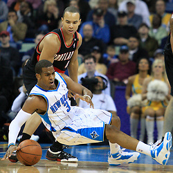 02 February 2009:  New Orleans Hornets guard Chris Paul (3) slips as Portland Trailblazers guard Jerryd Bayless (4) defends during a 97-89 loss by the New Orleans Hornets to the Portland Trail Blazers at the New Orleans Arena in New Orleans, LA.