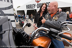 Maybe he'll get lucky for his birthday? Fred Harwood and Mary Beth Grandner of Florida test a 2015 Road Glide at the busy Harley-Davidson display at Daytona International Speedway on the first day of Daytona Beach Bike Week 2015. FL, USA. Saturday, March 7, 2015.  Photography ©2015 Michael Lichter.