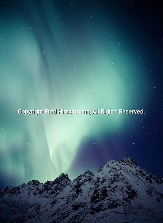 Aurora above the Talkeetna Mountains, Archangel Valley, early morning hours of December 27, 2002, Alaska.