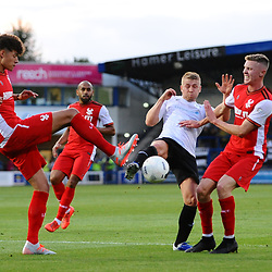 TELFORD COPYRIGHT MIKE SHERIDAN Darryl Knights battles for the ball with Harriers' Rhys Williams during the National League North fixture between AFC Telford United and Kidderminster Harriers on Tuesday, August 6, 2019.<br /> <br /> Picture credit: Mike Sheridan<br /> <br /> MS201920-006