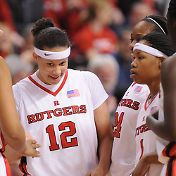 Feb 24, 2009; Piscataway, NJ, USA; Rutgers forward April Sykes (12) is congratulated for getting the scoring monkey off her back during the second half of Rutgers' 71-52 victory over Cincinnati at the Louis Brown Athletic Center.