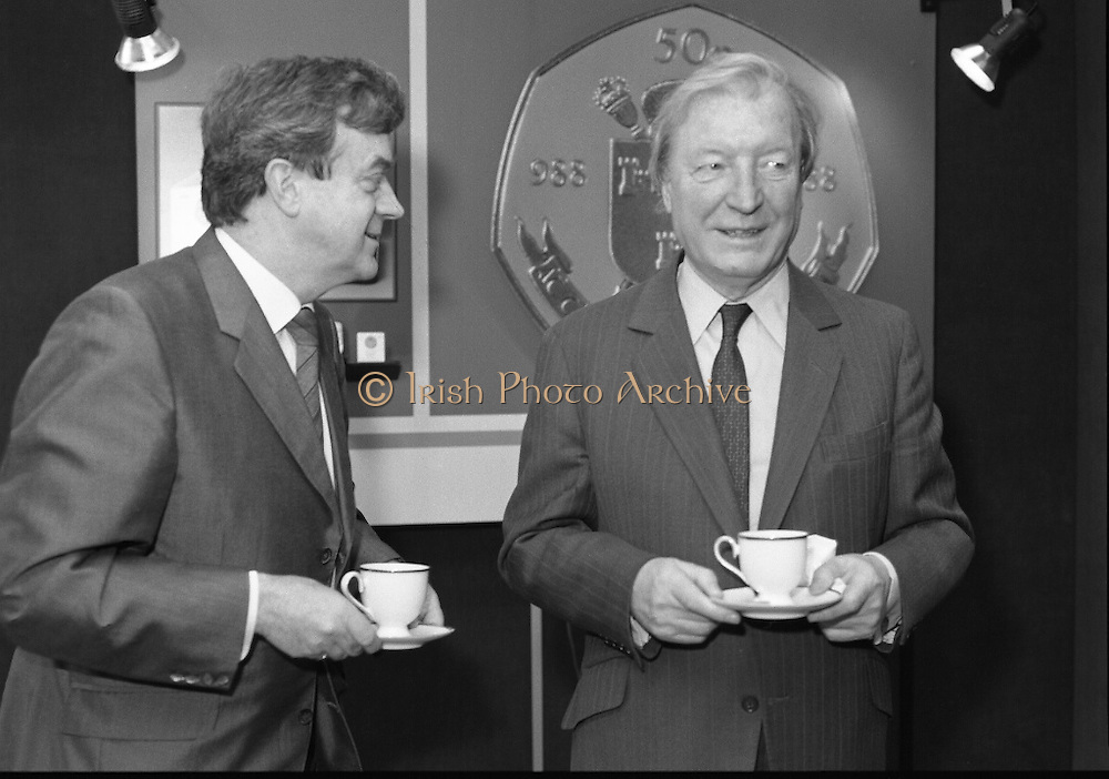 First Millennium 50p Coin.   (R80)..1988..31.06.1988..06.31.1988..31st June 1988..The Governor of the Central Bank of Ireland, Mr Maurice F Doyle, presented the first of a limited issue of proof 50p coins commemorating the Dublin Millennium to An Taoiseach, Charles Haughey TD, this morning. Only 50,000 of these frosted proof coins will be issued for worldwide distribution...An Taoiseach, Charles Haughey TD, and Mr Maurice Doyle, Governor of the Central Bank are pictured having a cup of tea before the presentation of the new 50p coin.
