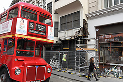 © Licensed to London News Pictures. 06/09/2018. LONDON, UK.  A historic building at 229 Strand in central London has been made safe by workmen after a bus was reported to have damaged the exterior earlier in the day.  Situated opposite the Law Courts, the property was built in 1625 and originally housed The Wig and Pen, becoming a favourite watering hole for lawyers and journalists during Fleet Street's heyday.  It is the only building in the Strand to survive the Great Fire of London of 1666 and today houses a Thai restaurant. Reconstruction and repair has yet to be undertaken. Photo credit: Stephen Chung/LNP