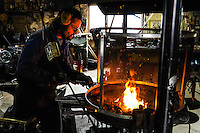 Norway, Lofoten. Sund is a small fishing village on the soutwest corner of Flakstadøya. The famous blacksmith in Sund, forging items which is sold to tourists.
