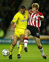 Photograph: Scott Heavey.<br />Southampton v Charlton Athletic. FA Barclaycard Premiership. 07/12/2003.<br />Michael Svensson (R) battles with Jonathan Fortune