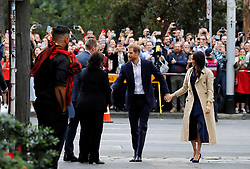 The Duke and Duchess of Sussex arrive to visit a mural created by Gunnai and Waradgerie man Robert Young near Mission Australia social enterprise restaurant Charcoal Lane in Melbourne, on the third day of the royal couple's visit to Australia.