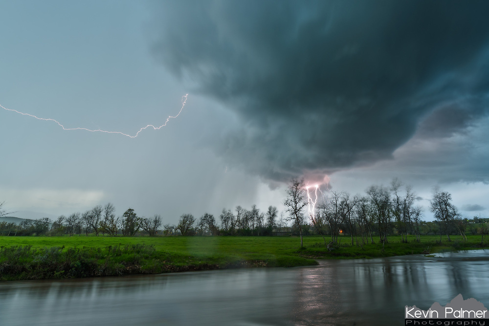 Just before the drenching rain started, I took one last shot and captured this bolt of lightning, reflected in Big Goose Creek.