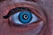 Extreme closeup of a human eye - blue