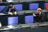 """25 MAR 2020, BERLIN/GERMANY:<br /> Jens Spahn (L), CDU, Bundesgesundheitsminister, und Olaf Scholz (R), SPD, Bundesfinanzminister, im Gespraech. Um das Abstandsgebot zu beachten, ist nur jder dritte Platz in den Abgeordnentenreihen besetzt, Bundestagsdebatte zu """"COVID 19 - Kreditobergrenzen, Nachtragshaushalt, Wirtschaftsfonds"""", Plenum, Reichstagsgebaeude, Deutscher Bundestag<br /> IMAGE: 20200325-01-021<br /> KEYWORDS: Pandemie, Corona, Sitzung, Debatte, Gespräch"""
