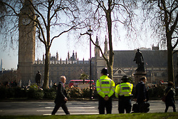 © Licensed to London News Pictures . 28/03/2017 . London , UK . Police on duty in Parliament Square opposite Parliament in Westminster nearly a week after Khalid Masood's terrorist attack and the killing of PC Keith Palmer . Photo credit: Joel Goodman/LNP
