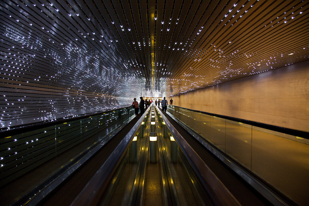 """The spectacular and mesmerizing """"Multiverse"""" by American artist Leo Villareal is a moving walkway with light-emitting diodes (LEDs), Mac mini, and electronic circuitry, installed between the concourse walkway of the East and West buildings of the National Gallery of Art in, Washington, DC."""