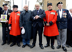 © Licensed to London News Pictures. 02/05/2012. London, UK London Mayor, Boris Johnson (centre, Black Suit) is joined by comedian Al Murray to wave off an army of WWII veterans who are embarking on an iconic trip to the Netherlands, via a convoy of black cabs. The London Taxi Benevolent Association for the War Disabled has organised a trip for 160 WWII veterans to travel to Holland in 80 London Black Cabs. The veterans, mostly aged between 85 and 94, will start their journey from London today 2nd May 2012 and will be visiting sites of importance from WWII and taking part in Dutch Liberation Day celebrations as guests of honour of the Dutch Royal Family.. Photo credit : Stephen Simpson/LNP