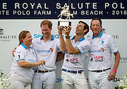 May 4, 2016 - Wellington, FL, United States - <br /> <br /> Prince Harry helps hoist the winner's trophy after playing a charity polo match in Wellington Florida on May 4, 2016. <br /> ©Exclusivepix Media