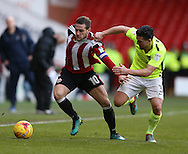 Billy Sharp of Sheffield Utd tussles with David Buchanan of Northampton during the English League One match at Bramall Lane Stadium, Sheffield. Picture date: December 31st, 2016. Pic Simon Bellis/Sportimage