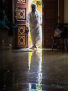 10 APRIL 2015 - BANGKOK, THAILAND: A Muslim man walks into Masjid Ton Son in Bangkok before Friday prayers. (Masjid is the Thai word for Mosque.) A Pew Research Center study recently released identified Islam as the fastest growing religion in the world. Masjid Ton Son was the first mosque in Bangkok, founded in 1688 during the reign of King Narai, of the Ayutthaya era. Muslims are about 5 percent of Thailand, but make up a bigger proportion of Bangkok. Thailand's deep south provinces are Muslim majority.    PHOTO BY JACK KURTZ