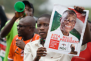 A young man holds up a poster portraying opposition leader John Atta Mills during a rally in Tema, roughly 30km east of Ghana's capital Accra on Friday December 5, 2008. Ghanaians are voting in a presidential election on December 7 as incumbent John Agyekum Kufuor, leader of the New Patriotic Party (NPP),  is to step down after ruling for 2 consecutive 4-year terms.