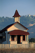 Historic old 19th century wooden one room schoolhouse at San Simeon, below Hearst Castle, California