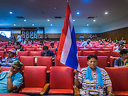 14 DECEMBER 2013 - BANGKOK, THAILAND: A man holds a Thai flag during an anti-government political reform forum in Bangkok. The Thai anti-government movement, called the People's Democratic Reform Committee (PRDC) sponsored a forum Saturday to establish guidelines for political reform in Thailand. The opposition leader, Suther Thaugsuban, said his movement will not participate in a similar forum, sponsored by the government scheduled for Sunday. Thailand's political impasse continues with the opposition calling for the caretaker government of Prime Minister Yingluck Shinawatra to step down. Yingluck has, so far, refused to step down from her caretaker roll. Crowds at the anti-government rallies have shrunk substantially since the collapse of the government earlier in the week.        PHOTO BY JACK KURTZ