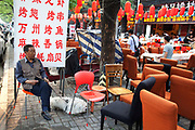 "Customers eating and waiters serving as red lanterns hang overhead along Guijie food street, the famous eating street in Beijing, China. known to locals as 'Ghost Street' as it remains open 24 hours a day, eating on Ghost Street is about more than food and drink, it's a way of life for many Beijingers. Tucked behind Dongzhimen Street, ""Ghost Street"" stretches 1.5km and contains more than 150 shops, including 100 restaurants, making it one of the most unique streets in Beijing."
