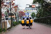 Tokyo, Iidabashi - Three children in school uniform in iidabashi.