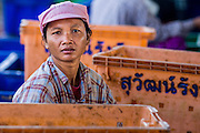 30 OCTOBER 2012 - PATTANI, PATTANI, THAILAND: A Burmese migrant worker in the Thai fishing port of Pattani. Thailand's fishing industry relies on immigrant workers, mostly from Myanmar but also Laos and Cambodia. There have been allegations of worker abuse, including charges that workers are held in slave labor like conditions. There are hundreds of thousands of immigrant workers in the Thai fishing industry. Most are from Myanmar (Burma) but there are also Cambodian and Laotian workers in the industry.    PHOTO BY JACK KURTZ