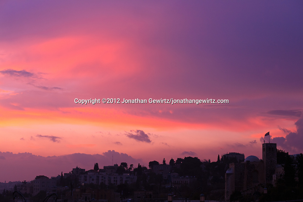 St. Andrews Scottish church and the Jerusalem skyline at sunset as seen from Yemin Moshe. WATERMARKS WILL NOT APPEAR ON PRINTS OR LICENSED IMAGES.