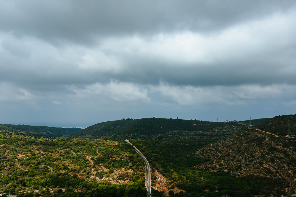A car drives down a road at Mount Carmel National Park in northern Israel