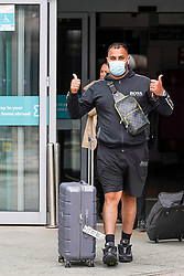 © Licensed to London News Pictures. 26/07/2020. Manchester , UK. A passengers wears a  face covering as he arrived at Terminal 3 at Manchester airport from Barcelona El Pratt airport with Ryanair low-cost carrier and fight number FR7543 this afternoon.The government announced  travellers returning to the UK from Spain from July 26th will need to self-isolate for two weeks. Photo credit: Ioannis Alexopoulos/LNP