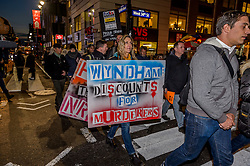 November 28, 2016 - New York, United States - In a protest at FedEx, Hertz, and Wyndham Worldwide locations in Midtown Manhattan, Gays Against Guns, a direct action group committed to end gun violence in America, will demand that the three companies halt their generous discounts for NRA members because some of the money that NRA members save with FedEx, Hertz, and Wyndham ends up in the NRA's bank account. That same NRA bank account siphons money straight to the gun lobby's bank account. (Credit Image: © Erik Mcgregor/Pacific Press via ZUMA Wire)