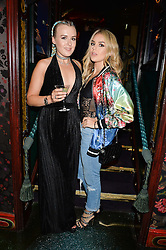 Left to right, sisters TESSIE HARTMANN and TALLIA STORM at a party hosted by fashion website Farfetch to launch i.am + EPs headphones hosted by Will.i.am at Loulou's, 5 Hertford Street, London on 16th September 2016.